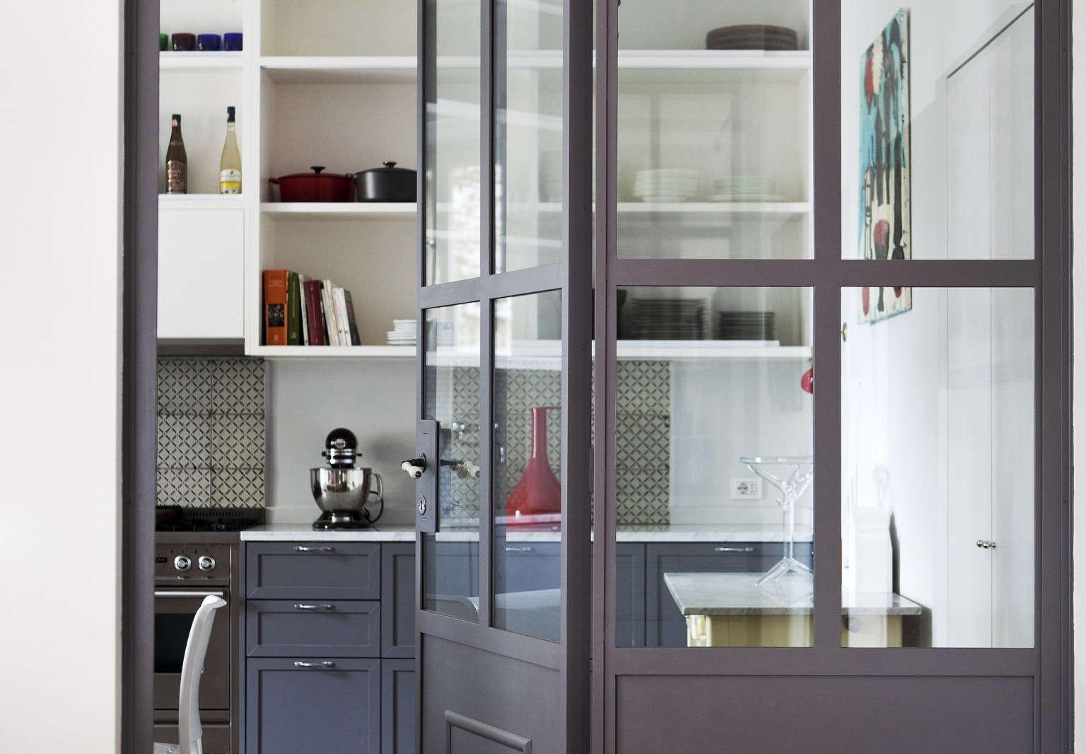studio strato tuscan red house rome doorway into kitchen serena eller