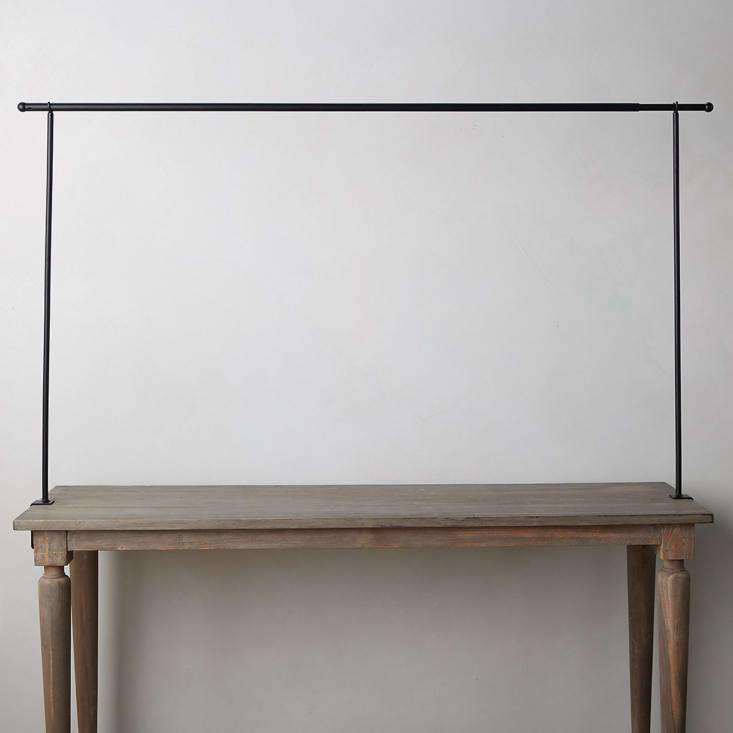 The adjustable Over-the-Table Rod is 38 inches high and can span from 55 inches to 98 inches.