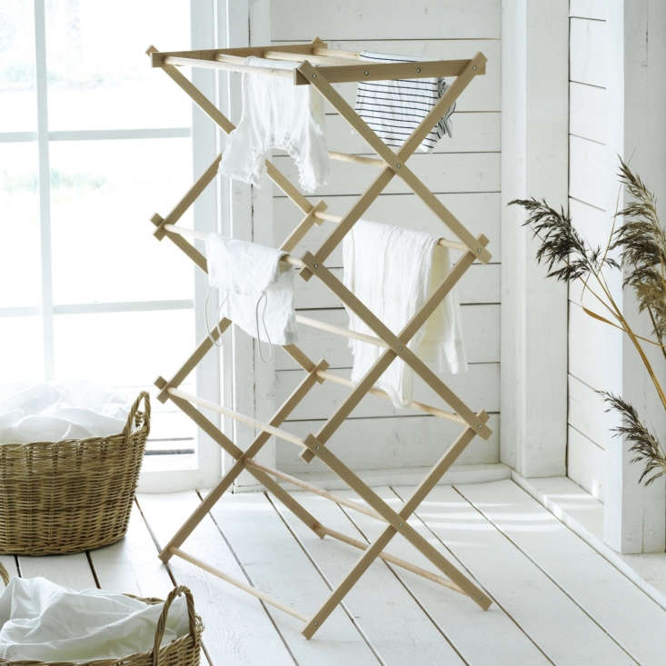 The Borstad line includes laundry solutions like a solid beech Drying Rack ($34.99) and a Basket with Handles ($29.99).