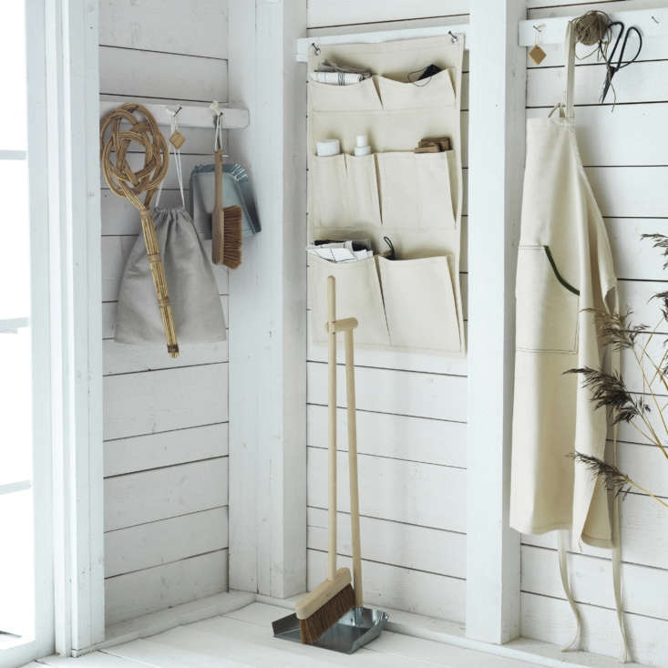 The products in the Borstad line are all made from natural materials such as hardwood, cedar, metal, rattan and canvas. From left: a rattan Carpet Beater ($5.99), a linen Shoe Bag ($4.99), a Dust Pan and Brush ($12.99), a Hanging Organizer ($12.99), a standing Dust Pan and Broom, ($19.99), and an Apron ($9.99).
