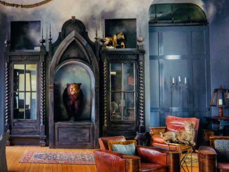 the great room is filled with curiosities, including a taxidermy bear and bobca 10