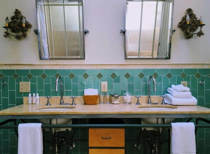a green tiled bathroom. 16