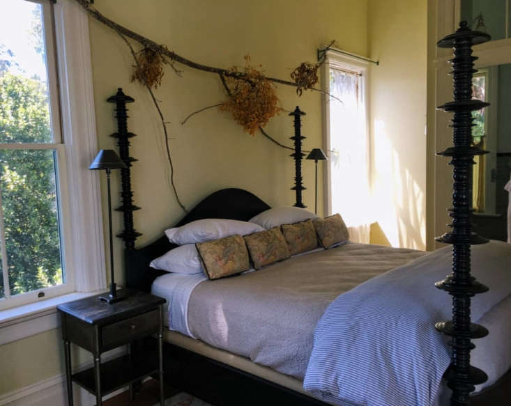 foraged branches and foliage above the bed in the master suite. 12