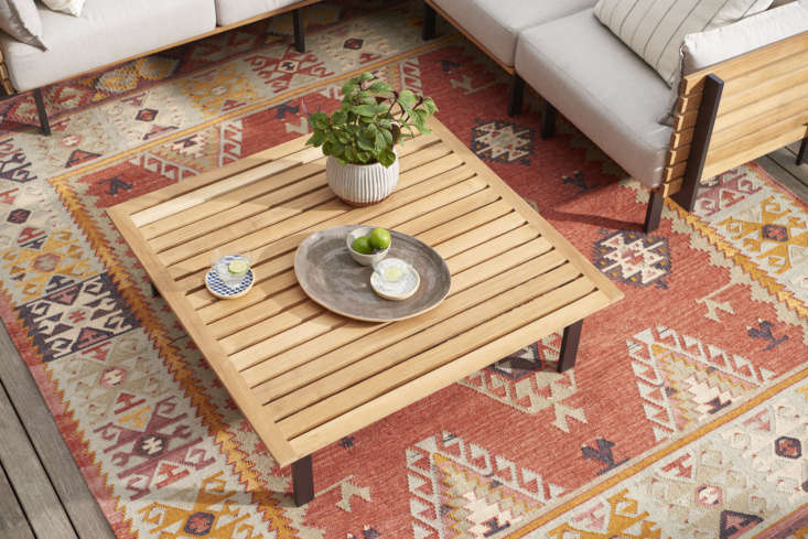 Set the Jasper Teak Coffee Table ($599) with drinks and snacks for cocktail hour en plein air.