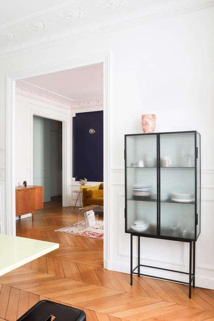 Classic Paris apartment modernized by Heju Studio architecture.