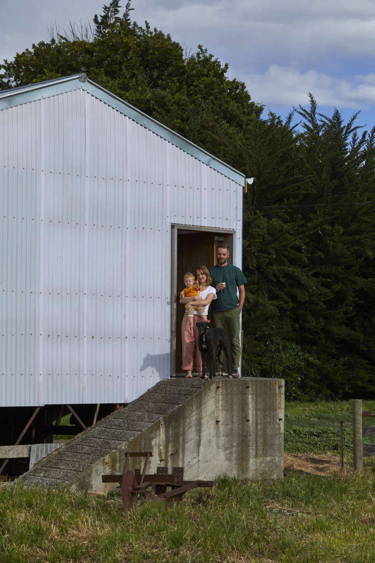 Architect Ben Daly and family outside their converted shearing shed they call home, Canterbury, NZ. Samuel Hartnett photo.