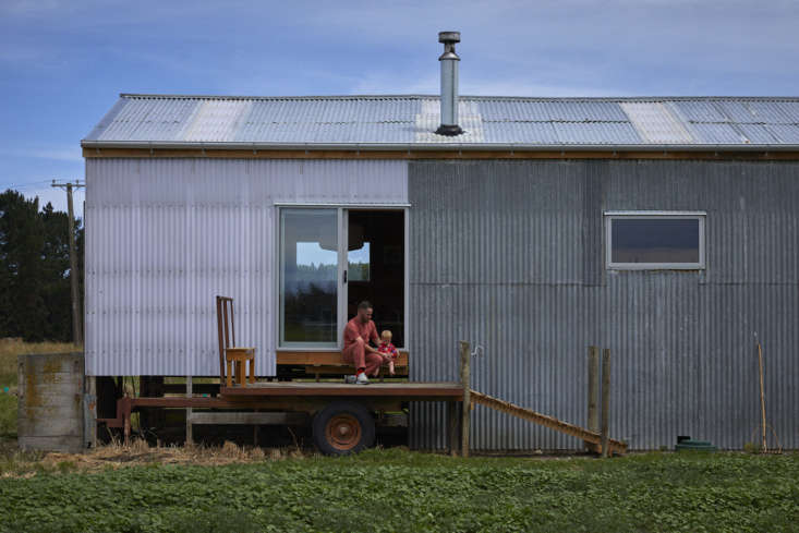 Architect Ben Daly and daughter outside their converted shearing shed they call home, Canterbury, NZ. Samuel Hartnett photo.