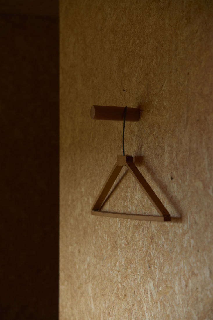 Peg with handmade wooden clothes hanger, the shearing shed, architect Ben Daly, Palace Electric, NZ. Sam Hartnett photo.