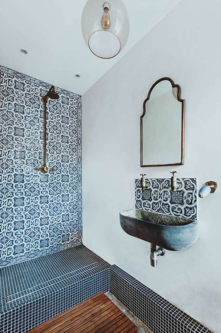 in one bath, the shower is tiled with portuguese azulejo tiles. &#8\2\20;th 18