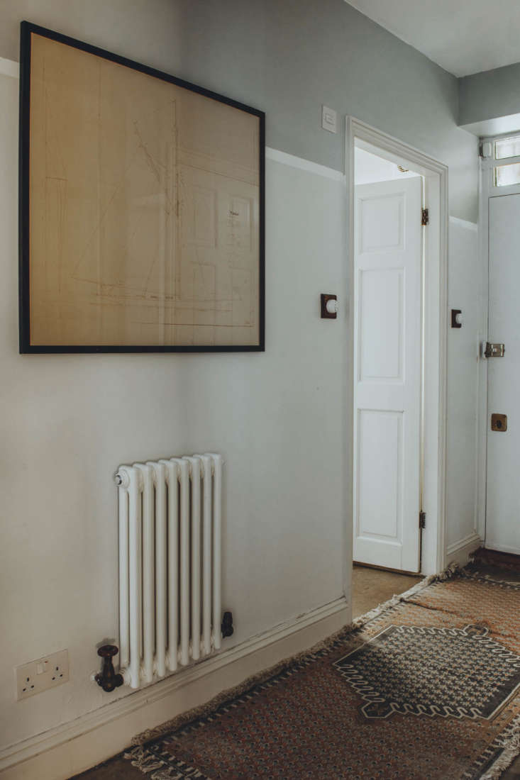 the hallway, layered with antique rugs. 20