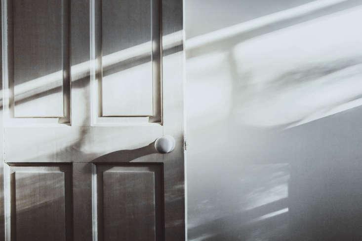 an original door, bathed in london light. 13