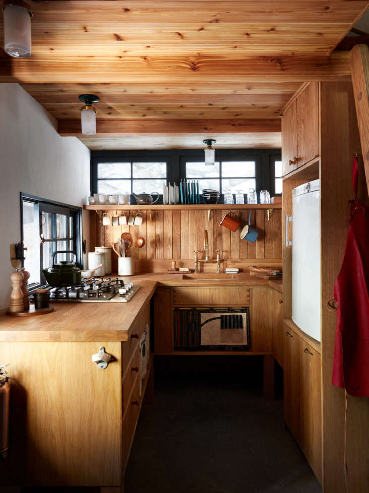 A small but efficient kitchen. Electricity comes from truck batteries, in a separate storage shed, that harvest solar power.