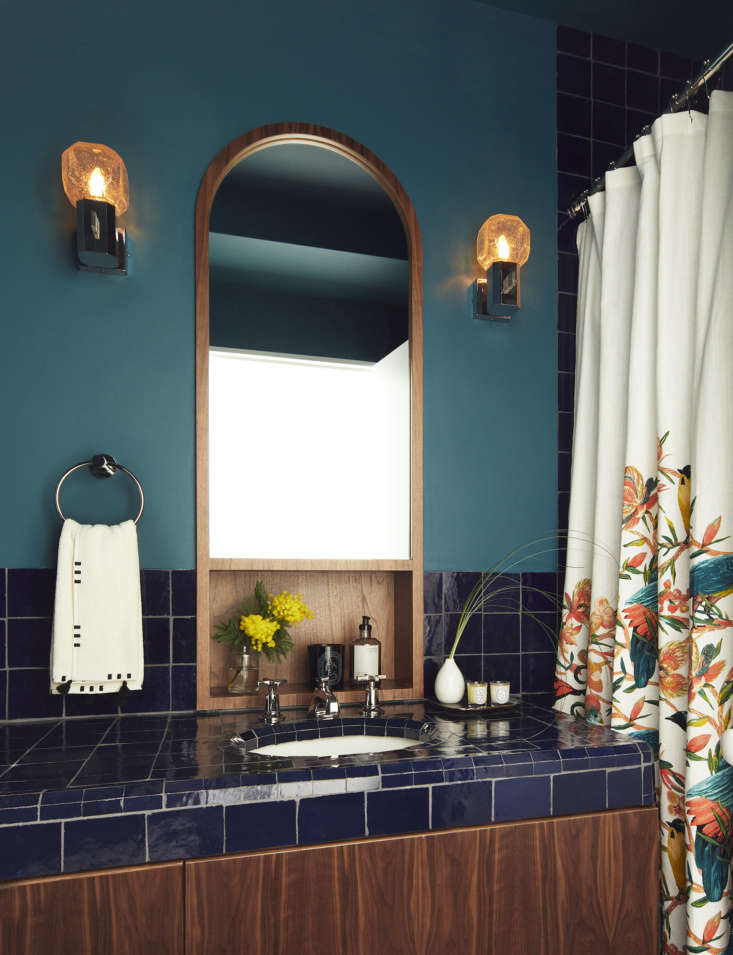 in the guest bath, the walnut millwork and mirror were custom designed by frede 19