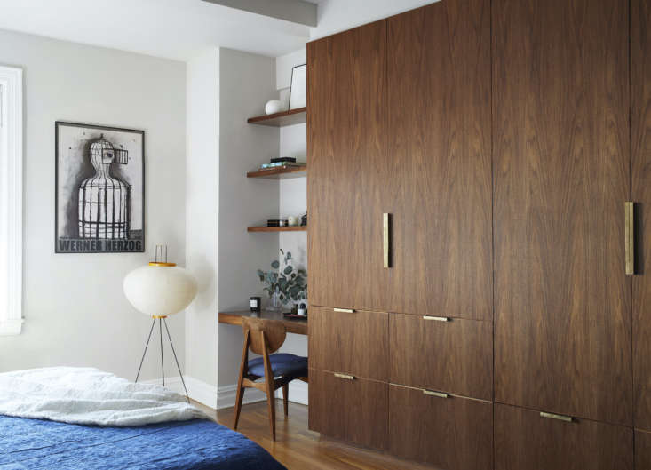 the firm designed the custom walnut closets. the floor lamp is a noguchi. (see� 14