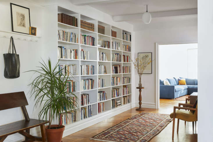 a built in bookcase and peg rail make this gracious entry feel more casual and  9