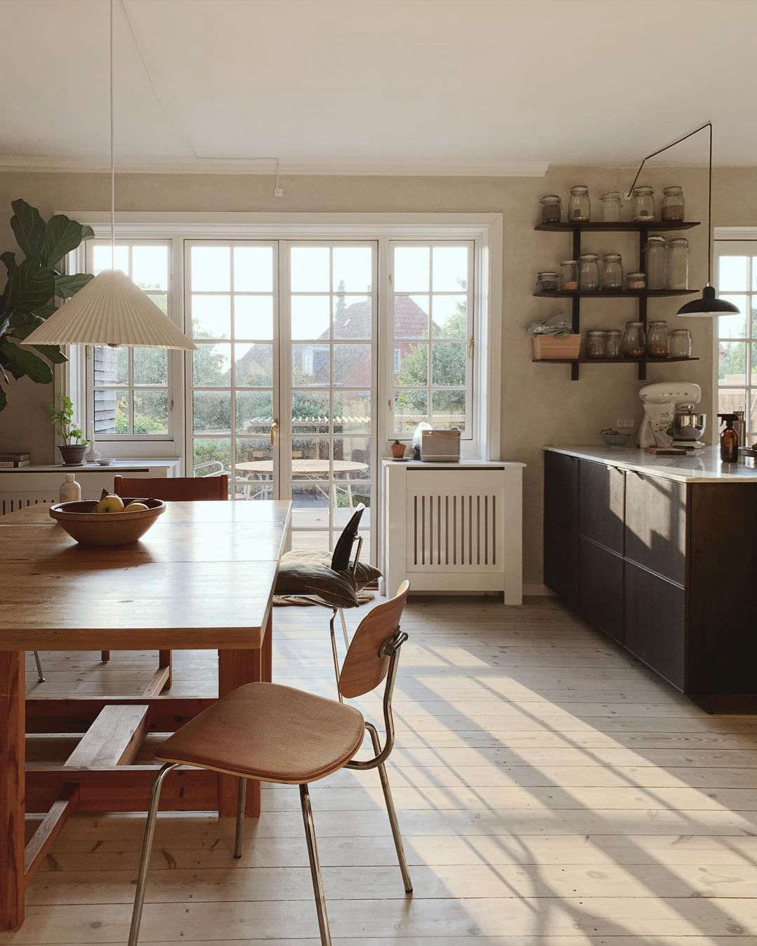 another view shows the kitchen, a once separate room that the couple opened up  10