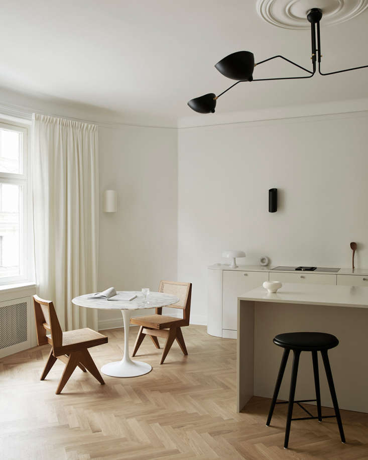 soft floor to ceiling curtains are another unusually elegant touch in this kitc 13