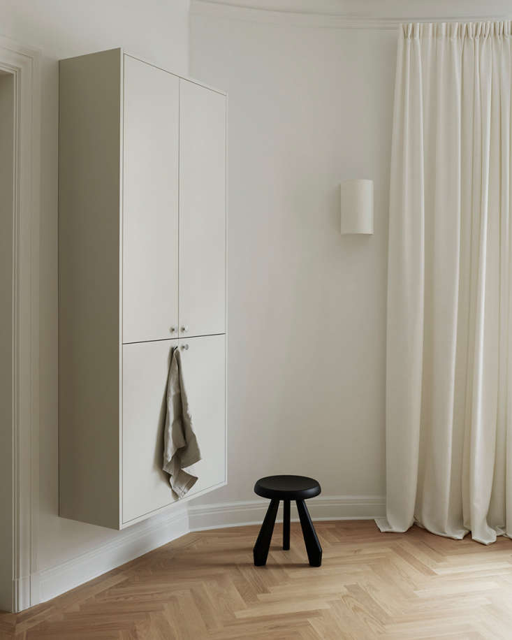 a tabouret meribel stool by charlotte perriand sits next to a floating wall uni 14