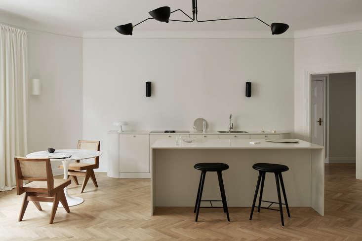 herringbone floors throughout add warmth to the minimalist design. 10