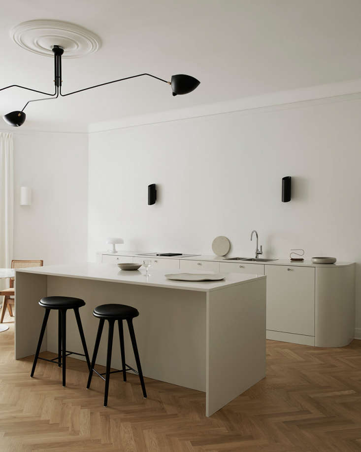 black accents—a serge mouille ceiling light, wall lights by serax, and stools 11