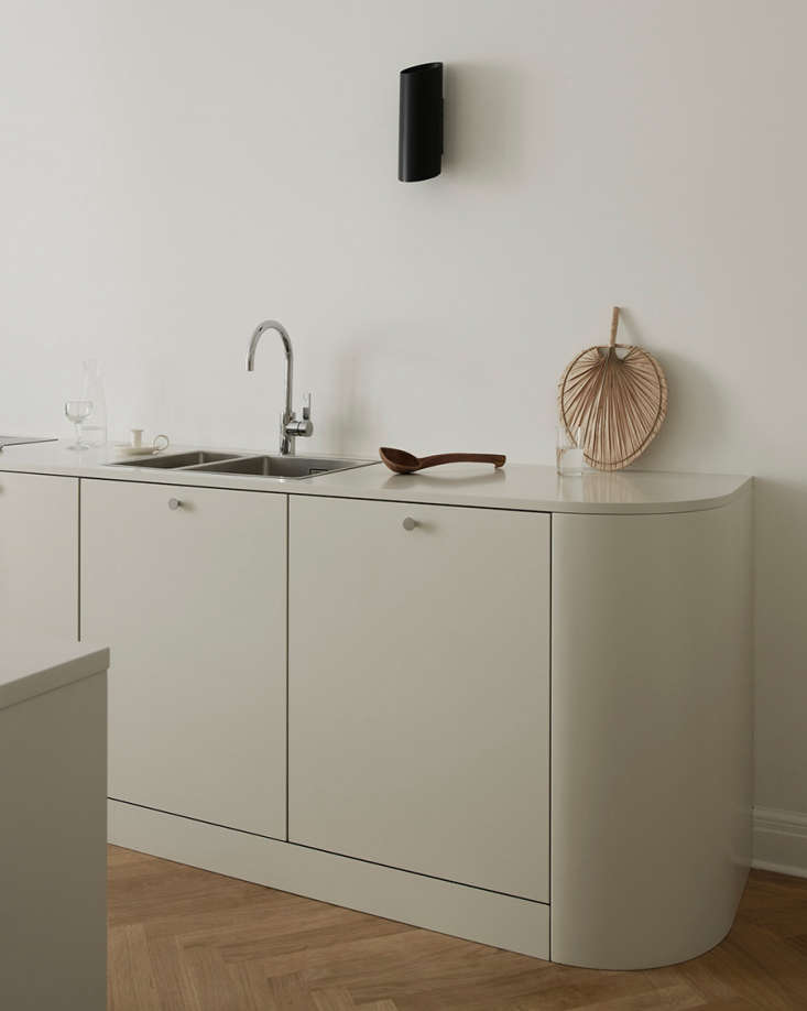 the rounded lower cabinets and countertop, more akin to a sideboard than kitche 12