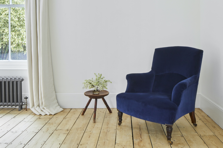a rare spot of color in the form of an armchair from colefax and fowler, reupho 18