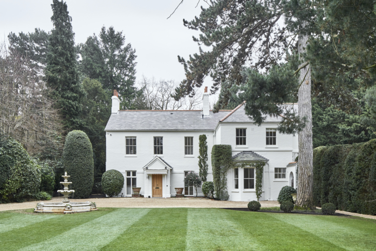 the house rests on seven acres of manicured grounds and woodland. the 100 year 9