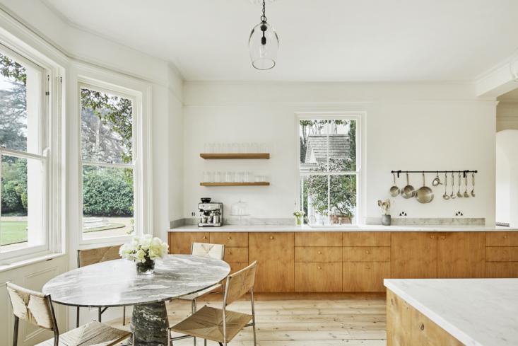 the custom made smoked oak kitchen cabinets are by københavns møbelsnedkeri. 11