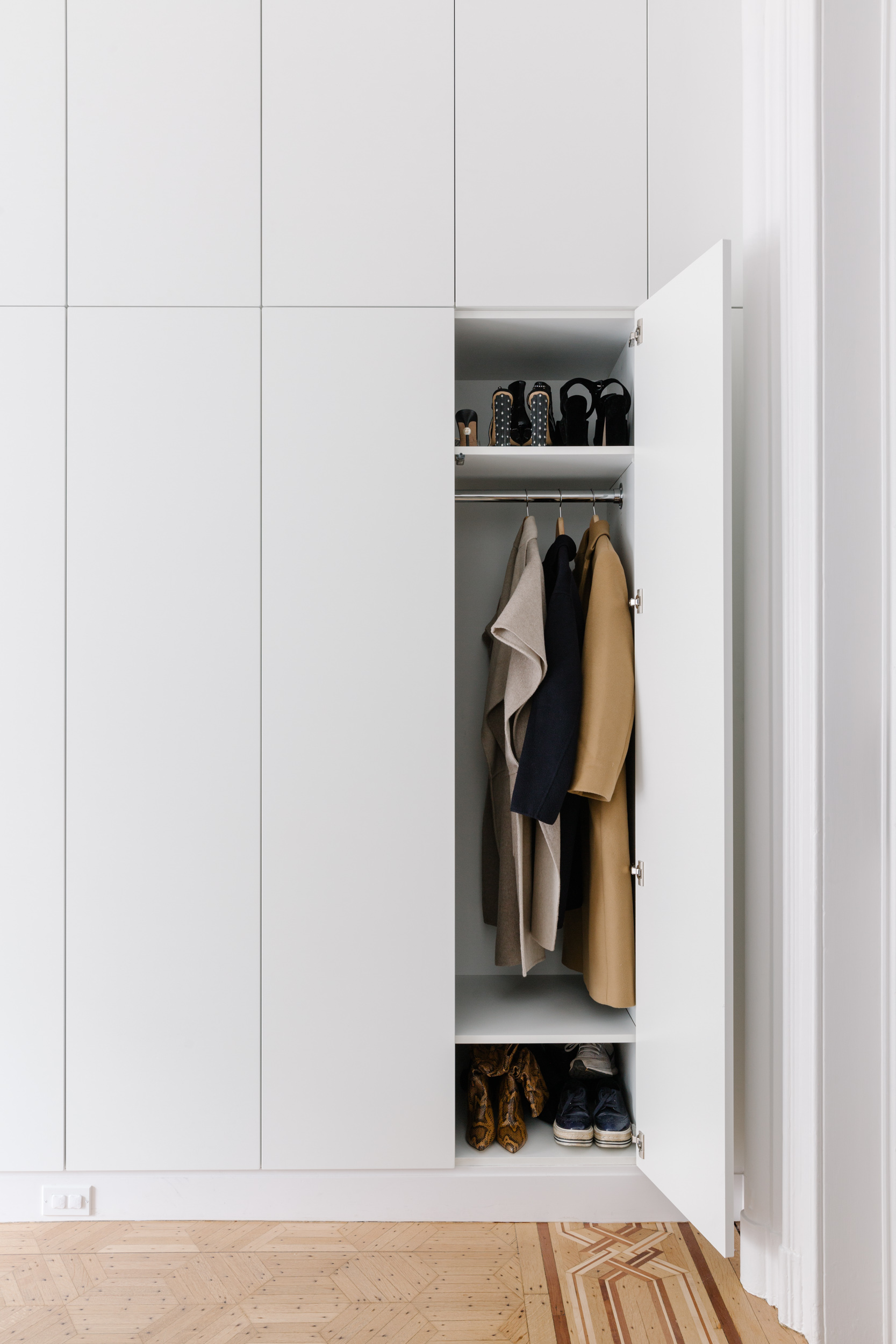 """""""The units are beautiful and are an upgrade from Ikea. They shipped quickly, so there wasn't a long lead time,"""" say Barry and Jordan. """"We love California Closets, but with 15 feet of closet, these units were much more affordable for a renovation on a tighter budget."""""""