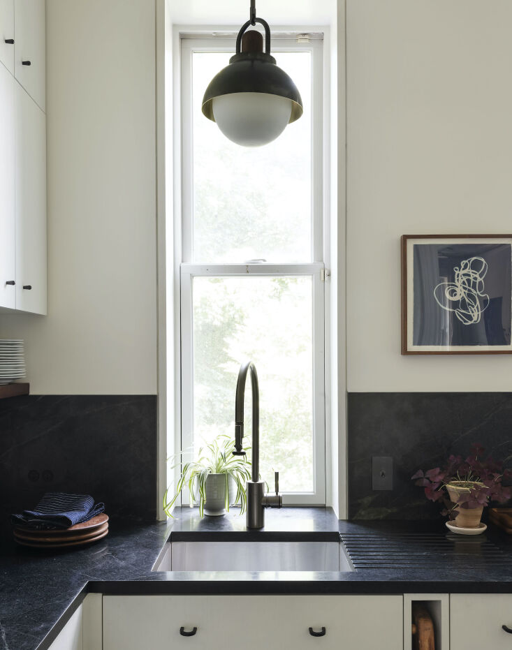 Current Obsessions Upcycled Finds Black soapstone counter in architect Elizabeth Roberts' own Brooklyn kitchen remodel.