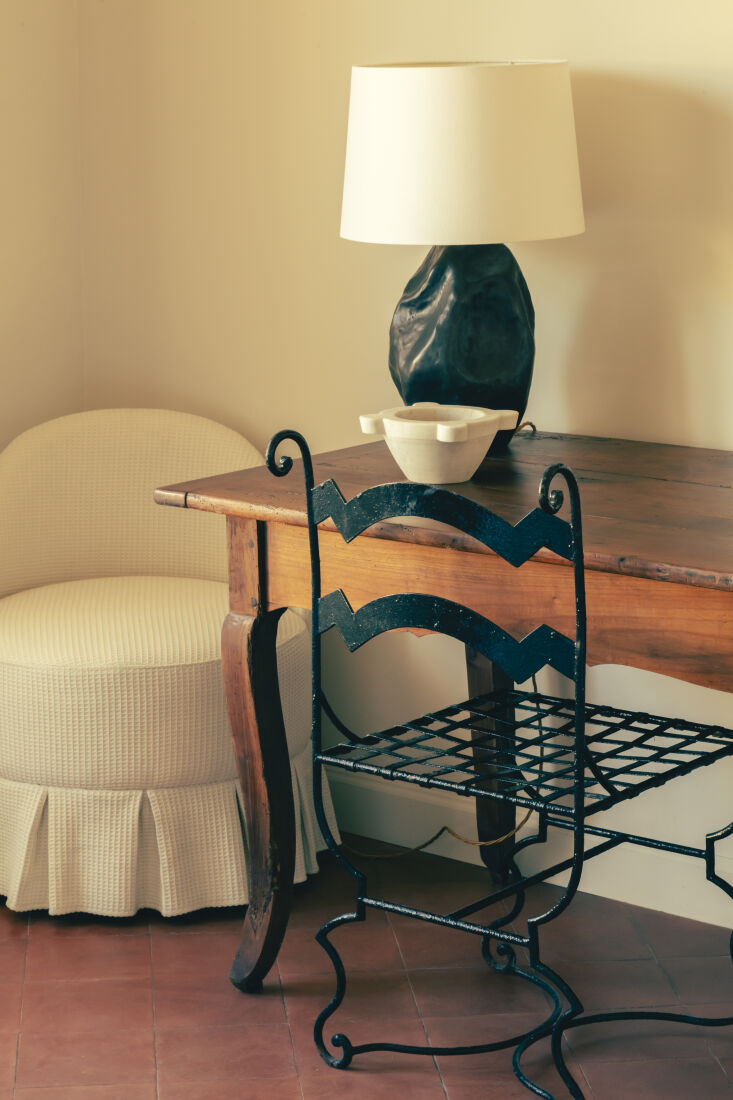 OldWorld French Summer Htel La Ponche in SaintTropez A wrought iron chair and vintage table in a guest room.