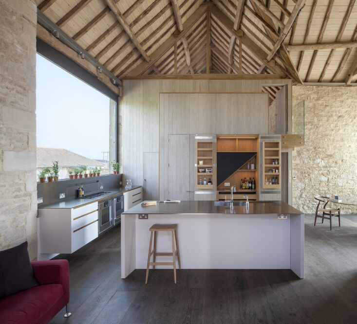 Kitchen of the Week A Modern Barn Conversion in the English Countryside The weathered oak paneled volume conceals the stairs that lead to the loft and houses a double pantry, refrigeration, and under stair storage. It was built and tested off site before getting installed.
