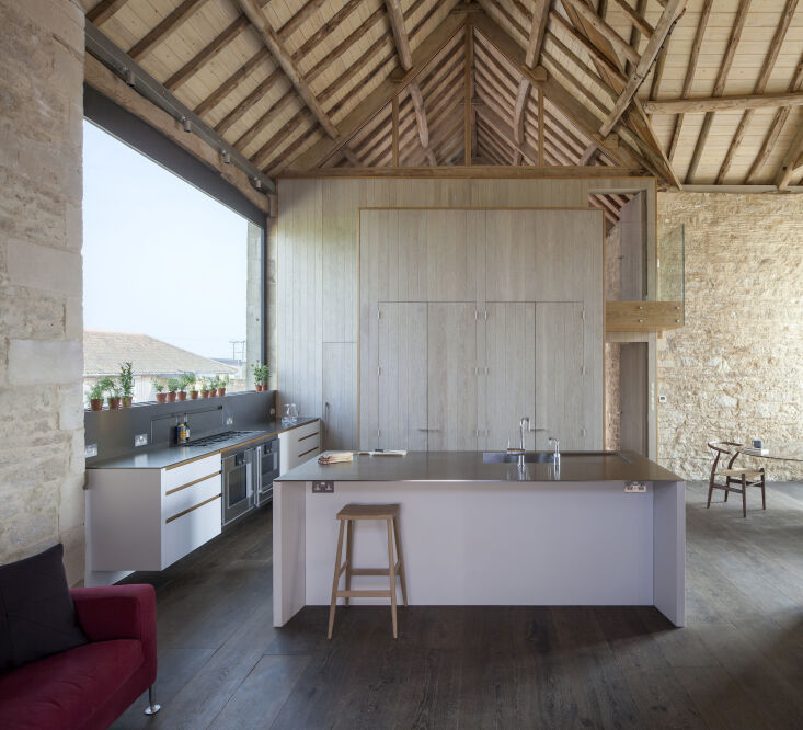 Kitchen of the Week A Modern Barn Conversion in the English Countryside An open kitchen and living area comprises the airy first floor. Behind the weathered oak paneled wall is a staircase that leads to the lofted sleeping quarters.