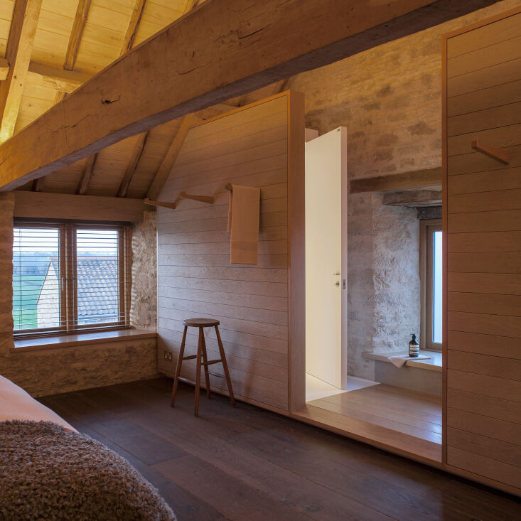 Kitchen of the Week A Modern Barn Conversion in the English Countryside A peek at the lofted bedroom, where the same materials palette continues.
