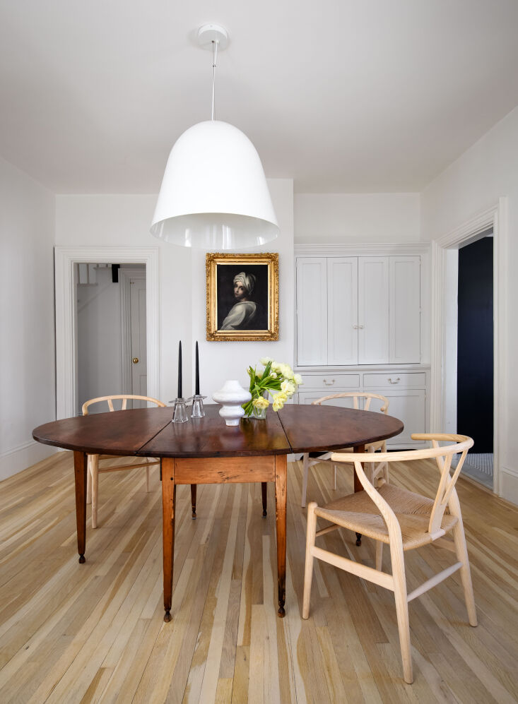 A Game of Clue A Stylists Redone Victorian Cottage in New England The pared back dining room, with newly added reclaimed white oak floors (&#8\2\20;downstairs, the original floors were in too poor a condition to save,&#8\2\2\1; Krissy explains).