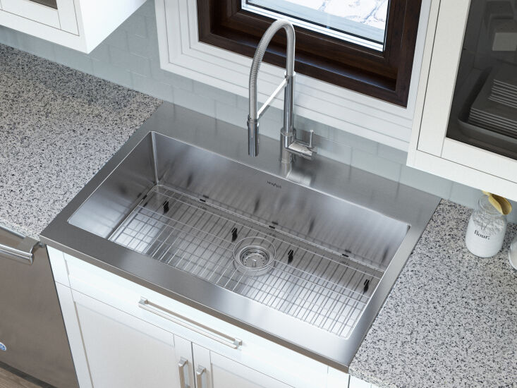 OneStop Modular Kitchen Solutions from NewAge Products Above: The company's premium 304 stainless steel kitchen sinks are available in a variety of drop in, undermount, and farmhouse sink styles and in deep basin options and multiple sizes, too. In addition to being corrosion resistant, easy to wipe down, and sound dampening, they all fit seamlessly into NewAge cabinets. Also available is an Under Sink Organizer (\$\13\1.74), ideal for storing cleaning essentials.