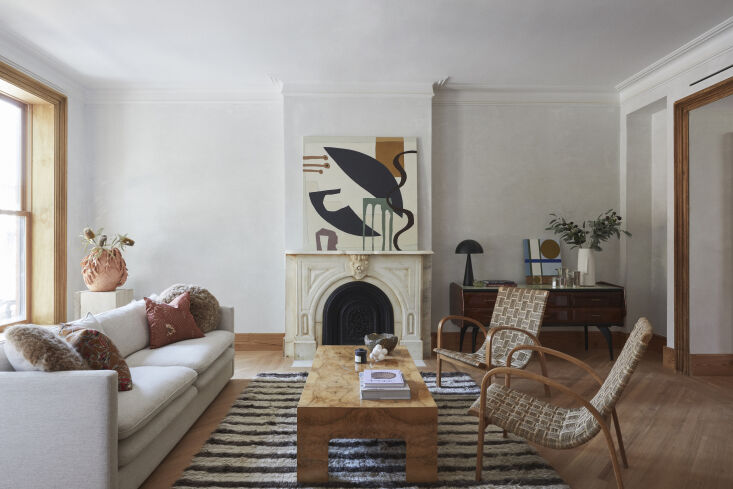 The architects restored the living room to its original dimensions and preserved the existing fireplace. Known for their celebration of simple materials, they applied Diamond veneer plaster walls and restored the original woodwork throughout. The floors are reclaimed heart pine from Provenance.