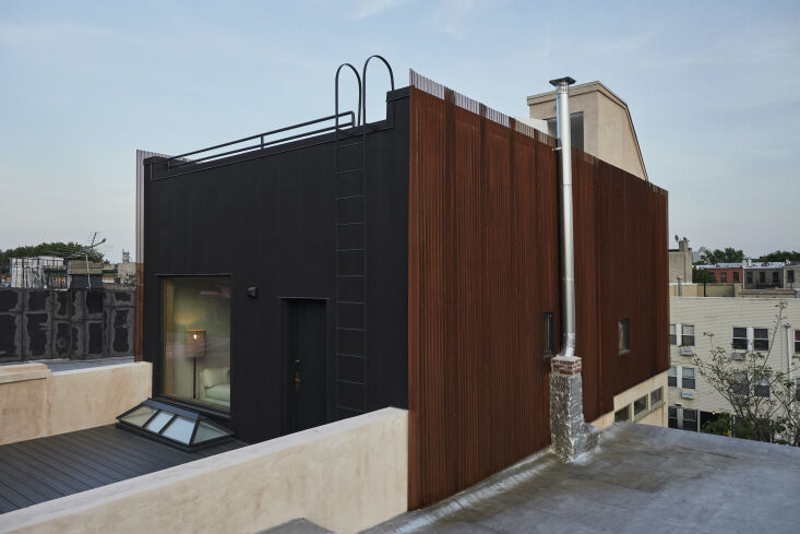 The top floor is clad in black corrugated steel and a weathered-steel rain screen: &#8\2\20;the layering of this cladding and the fact that light filters through it helps to subtly soften the scale,&#8\2\2\1; say the architects. &#8\2\20;It catches the evening sun brilliantly.&#8\2\2\1;