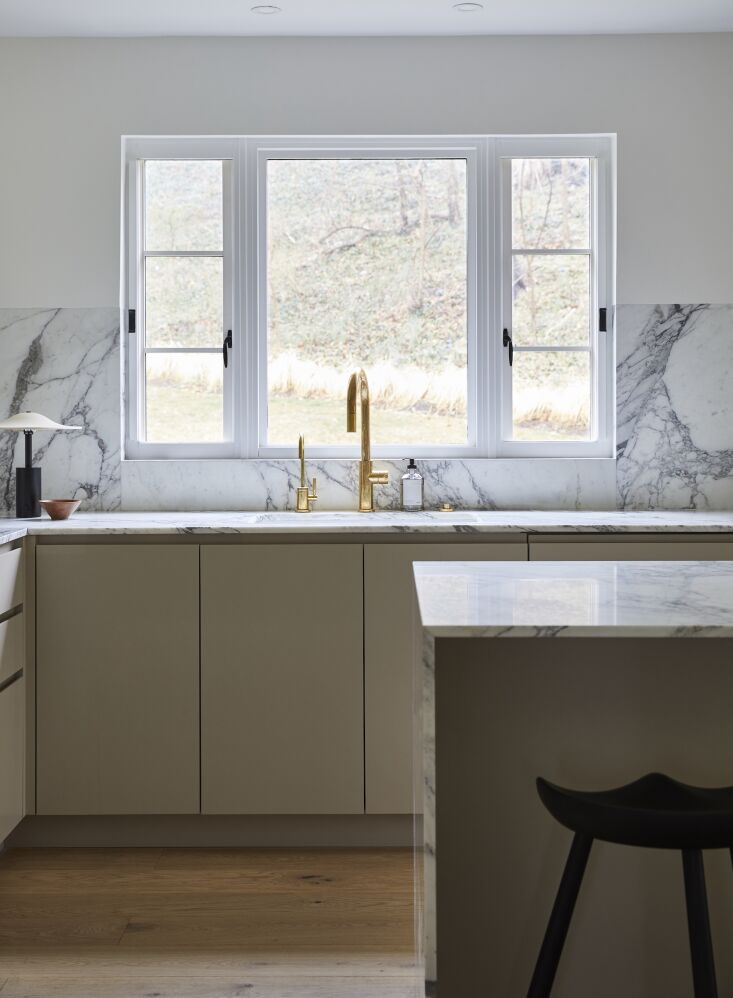 Kitchen of the Week In Connecticut a Japanese and MediterraneanInspired Room &#8\2\20;The Calacatta Vagli stone was the biggest investment here (natural stone usually is!), and it really makes such an impact. The slabs we chose have the most gorgeous color and veining. One of my favorite details is that the stone along the sink wall is flush with the wall above. It's such a small but beautiful detail.&#8\2\2\1;