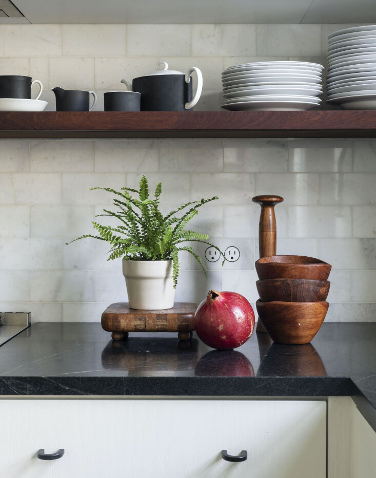 Current Obsessions Upcycled Finds Black soapstone counter and vintage wood table accessories in architect Elizabeth Roberts Brooklyn kitchen update