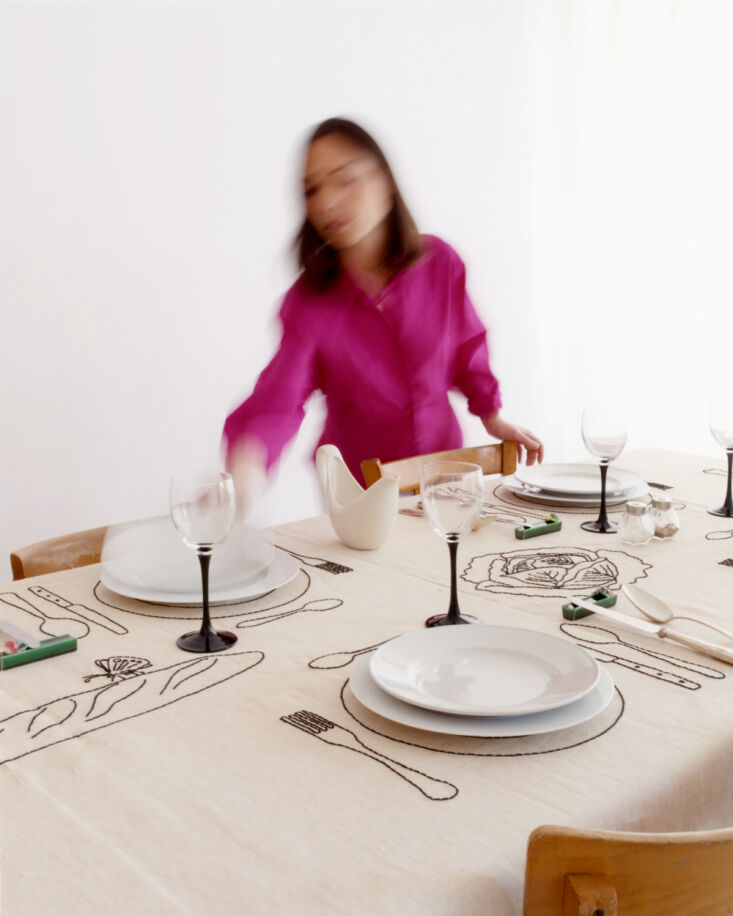The Table de Potager features antique linen and cotton hand embroidered with black cotton thread; €590.