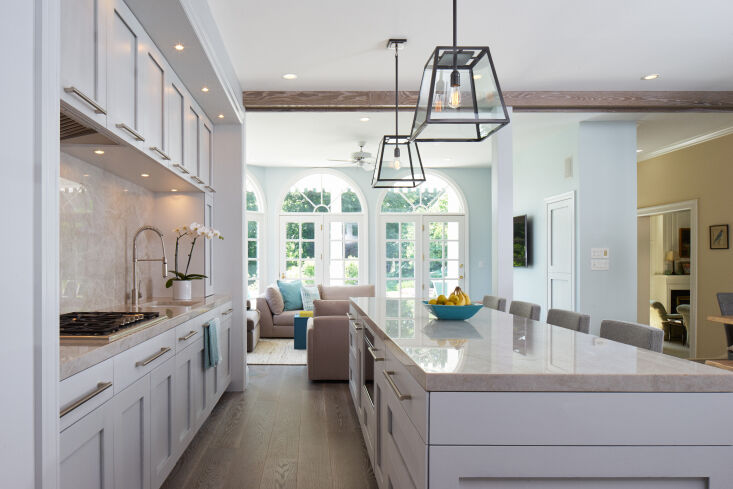 above: wide plank wood floors unite an open plan kitchen and sitting area in th 10
