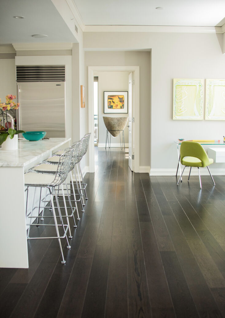 above: a dramatic mix: dark hued oak flooring with super modern steel chairs an 12