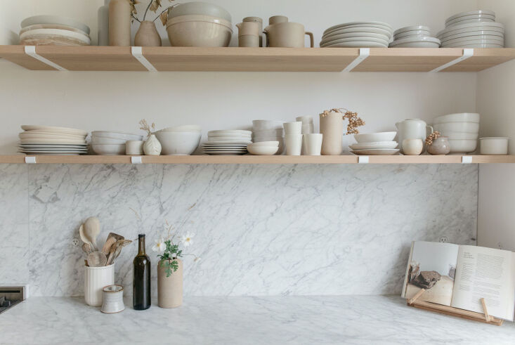 a must have for gillian? carrara marble countertops and backsplash. &#8\2\2 16