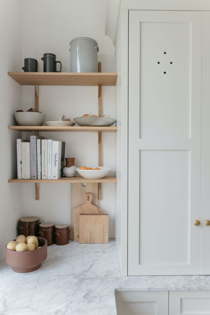 ferm living's oak and brass sector shelf is a perfect fit next to t 12