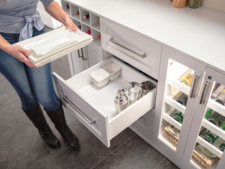 above: soft close drawers provide ample storage for serving platters and entert 16