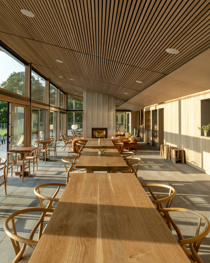 a two way fireplace separates the lounge from the communal dining hall, where f 12