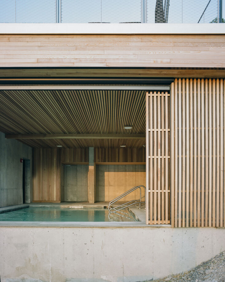on the lower level of the main building, a covered pool. 18