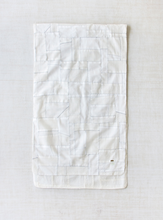 a white on white pojagi scarf from dosa, made from recycled khadi silk and cott 12