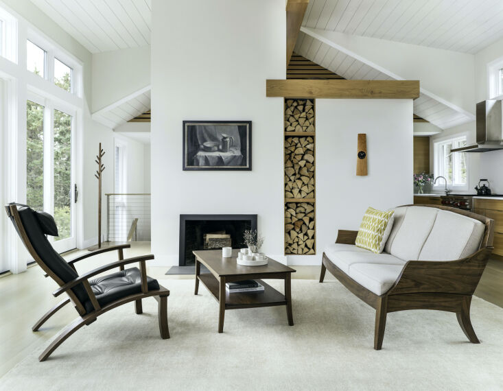 thos. moser's lolling chair (at left, from \$3,750) and three place wing sofa 10